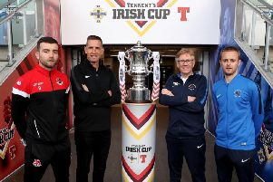 Crusaders captain Colin Coates, manager Stephen Baxter with Ballinamallard United manager Harry McConkey and captain Richard Clarke pictured with the Irish Cup at the National Football Stadium at Windsor Park.