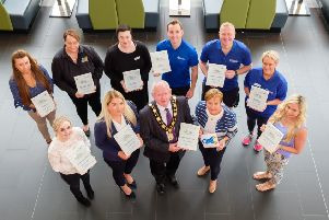 Mayor of Antrim and Newtownabbey, Ald John Smyth and Chief Executive, Jacqui Dixon receiving the Autism Impact Award from Orla Kelly of Autism NI. They are joined by the council's Autism Champions.