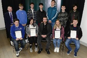 Students from Northern Regional College's Newtownabbey campus with tutor Michael Farrelly and PSNI Inspector Tate after receiving their #SoberingMoment certificates.