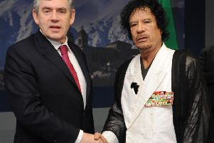 Prime Minister Gordon Brown meeting Muammar Gaddafi at the G8 Summit in L'Aquilla in 2009. Photo: Stefan Rousseau/PA Wire
