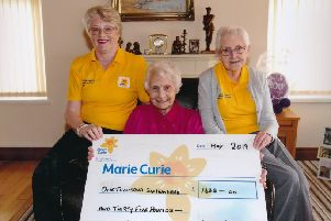 Roberta Bradley & Madge Reid from Marie Curie receiving a cheque for �1,635 from Kathleen Ferris, Limavady for donations on the occassion of her 100th birthday party held recently.