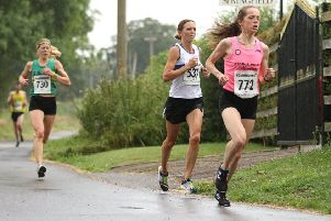 Kelly Edwards battles it out at the head of the field in the Northbrook 10k. Pictures: Tim Nunan