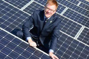 Cllr Warren Whyte on the solar-panelled roof of County Hall, Aylesbury