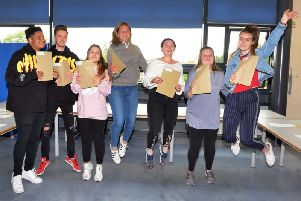 St George's Academy students celebrate receiving their A level and vocational course results. From left - Cameron Edonya, Alex Pearse, Chloe Roberts, Callie Thompson-Dowse, Tyler Priestley, Connie Bennett and Eve Russell. Photo Mick Fox