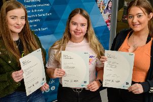Aimee McCombe, Jessica Miller and Lauryn Crawford celebrate their results at Northern Regional College's Newtownabbey campus where they have been studying Health & Social Care.