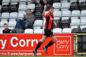 Philip Lowry celebrates finding the net at Seaview on Saturday for Crusaders against Dungannon Swifts.
