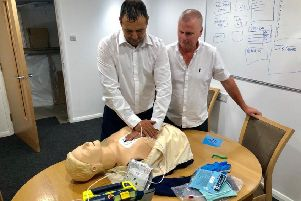 Raf is shown how to use a defibrillator by Simon Francis