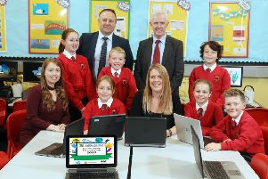 Primary 6 and 7 digital leaders from Ballyclare Primary with teachers Mrs Sarah Scott and Mrs Karen Irwin (cent. Also pictured are Pete Murphy from RM Education and Dr Victor McNair Digital Schools Validator.