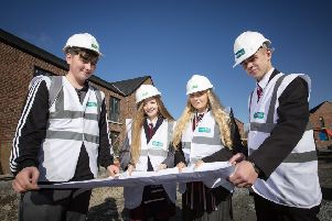 Pupils from Edmund Rice College, Hazelwood Integrated College, Glengormley High and Abbey Community College at Clanmil's Carnmoney Road site, Glengormley, where 48 new home are being built, as part of a campaign that promotes careers in the construction industry.