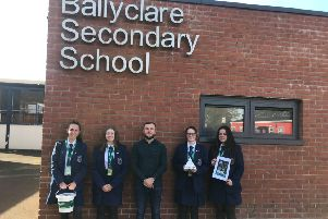 Concern's Community Fundraiser Dylan Murdock with Ballyclare Secondary School pupils.