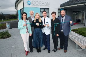 Holly cutting the ribbon at the purpose-built school.