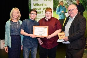 Presenting the award to Mark McClelland and Alex Chambers is Christine Chambers and Ken Brundle and from Ulster Wildlife.