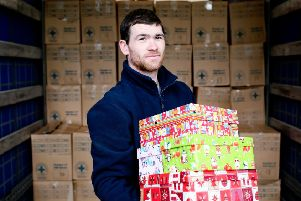 Daniel Horner, a member of Blythswood Ireland's logistical team, packing just some of the 14,700 shoe boxes providing much-need aid for deprived communities in Ukraine and Moldova.