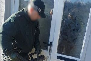 Police forced the door to gain entry to the premises (PSNI image).