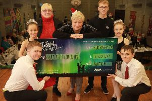 Barbara Logan, Asda Antrim Community Champion presents the �1k donation to Rathenraw Youth Scheme to Oliver Malone, Sarah McLaughlin, Sharon Brash, Adam Williamson, Grace McGrenaghan and Codey Williamson on behalf of Asda Foundation, Antrim.