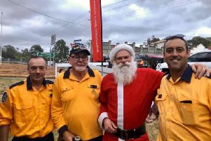 Roger Park (left) pictured with colleagues on Christmas Eve.