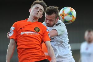 Cameron Dummigan (right) competing for Crusaders against Carrick Rangers on his weekend debut. Pic by Pacemaker.