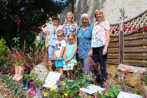 Four of the Cotton Land Girls, all members of Far Cotton Residents' Association, and two nursery pupils, pictured at their 'World War One Wellies' display on Towcester Road.