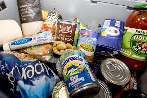 Members get to buy pre-packed boxes of food that Hope bosses have packed - to help supplement their diet.