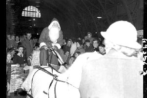 Father Christmas arrives at the Mercury Merry Comrades Christmas Bazaar at the Drill hall, Clare Street, Northampton, November 19, 1960