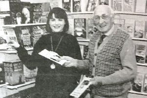 Lesley Price, owner of Dromore's first book shop, Bridge Books, pictured in 1995 placing books on the shelf by local author Andrew Dolingham,