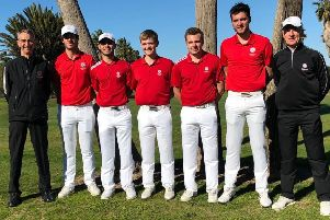 Sam Done (middle) with England team-mates and coaches in Spain EMN-190128-125457002