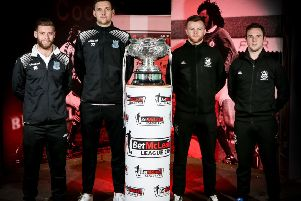 Ballymena's James Knowles and Adam Lecky along with Linfield players Niall Quinn and Jamie Mulgrew