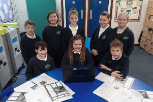 St Thomas' CofE School pupils with their work.