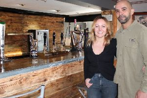 Husband and wife team, Gemma and Marlon Jones, inside the Boar's Head pub in Newmarket.