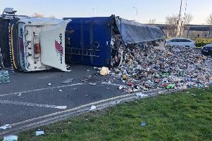 The overturned lorry is causing problems. Picture: Crawley Fire
