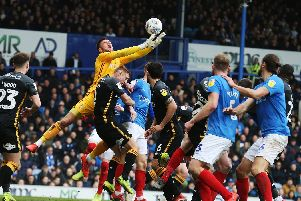 Bradford goalkeeper Richard O'Donnell attempts to claim a cross