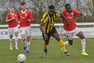 Junior English battles for possession with York's Adriano Moke. Pictures: Louise Smith