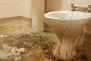 The bathroom was in a state of disrepair.