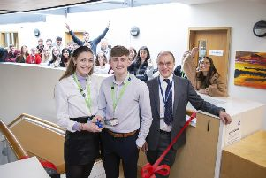 Head girl Emma Peel and head boy Hughie Johns pictured cutting the ribbon with head teacher David James. Picture: Kirsty Edmonds.