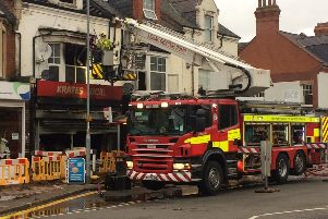 Fire crews at the scene of the fire this morning in Kingsley Park Terrace