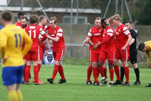 Horsham YMCA celebrate Jack Ryder's goal in their 4-2 away win over Lancing in the Premier Division on Saturday. All pictures by Derek Martin Photography.