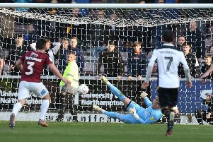 Tom Pope's penalty squirms through the legs of David Cornell. Pictures: Pete Norton/Getty Images