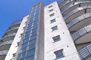 An investigation has been launched after rocks were thrown from the roof of the flats in Woolmonger Street on Saturday.
