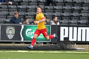 Sam Hoskins wheels away in delight after giving the Cobblers a 2-1 lead. Pictures: Pete Norton