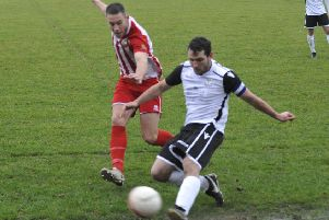 Action from November's reverse fixture between Bexhill United and Steyning Town. Picture by Simon Newstead