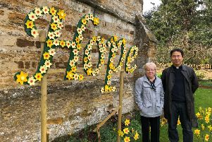 Ceila Irwin pictured with reverend Byung June Kim, stood next to her display at St Peter & St Paul's Church in Park Avenue South.