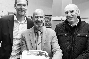 Two generations of owners for Jones Wholesale, with current owners Tom and Simon Allitt on the left and their father David on the right.
