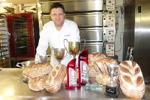 Lee Smith with his award-winning loaves SUS-190417-101616001