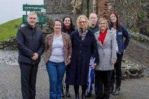 Adele McIvor, The Workspace Group (front row, right), with representatives from  the organisations which received support.
