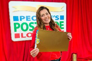 A report says a cap on charity funding raised by the postcode lottery is 'outdated'.
