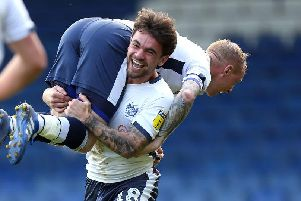 Nicky Adams and Dominic Telford celebrate for Bury during their win over the Cobblers. Picture: Pete Norton