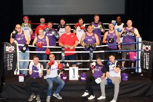 Chris Curry (centre, red shirt) surrounded by some of the Niamhs Next Step Fighting Fit Challenge participants (Picture: Alison Bagley)