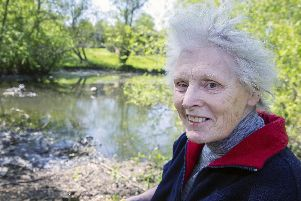 Bridget Owens pictured next to Kingfisher Lake which she has spent weeks clearing up alone.