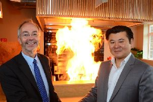 Bucks County Council leader Martin Tett and owner Kelvin Wong celebrate the opening of MIYA's new Japanese grill and bar