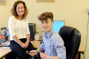 George Ashby, 16 with his mum Amelia who works at Lavant Road Surgery. Photo: Kate Shemilt. ks190337-3